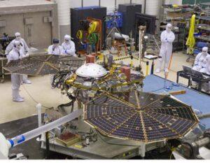 InSight Mars lander undergoing a solar array deployment test in the MTF clean room at Lockheed Martin.