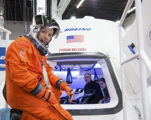 In this undated image provided by NASA, astronaut Randy Bresnik prepares to enter The Boeing Company's CST-100 spacecraft for a fit check evaluation at the company's Houston Product Support Center. AP PHOTO/NASA